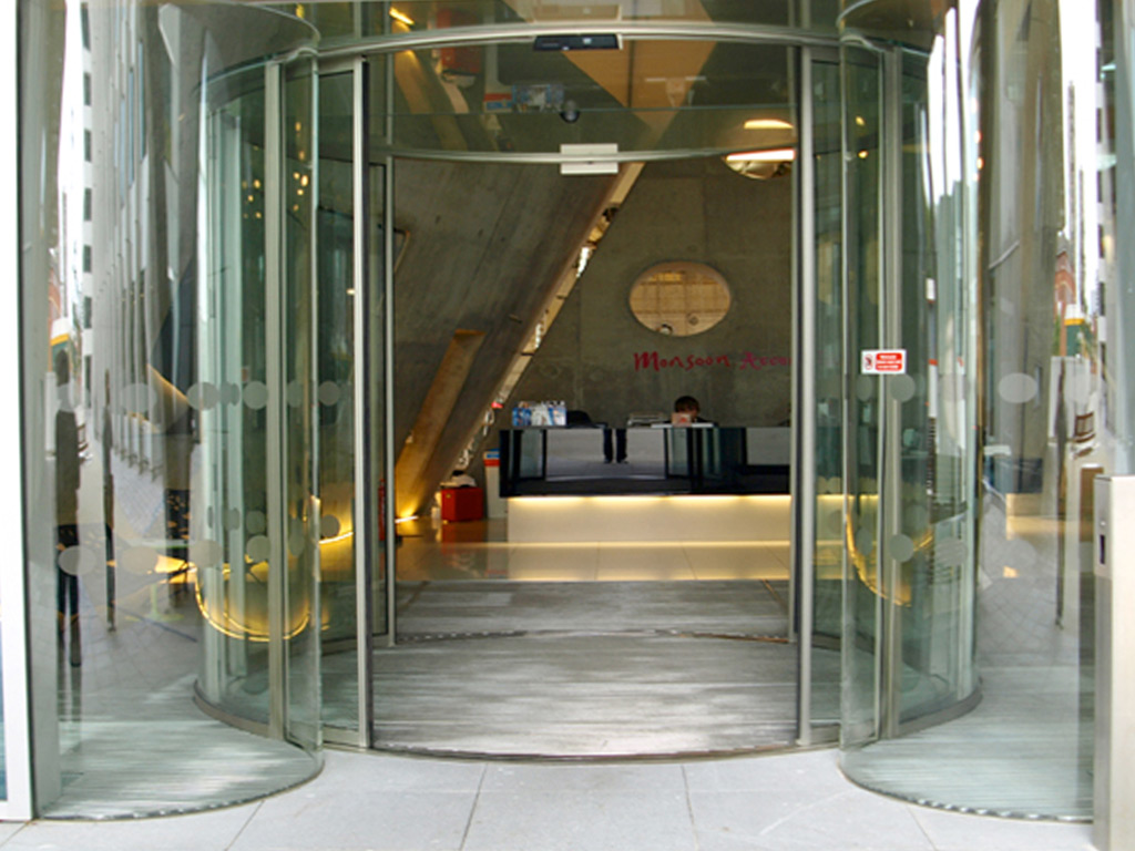 Tall Oversized Circular Sliding Glass Doors Over 3 Meters In